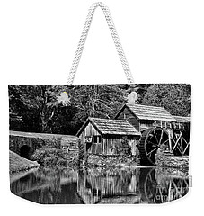 Weekender Tote Bag featuring the photograph Marby Mill In Black And White by Paul Ward