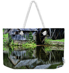 Weekender Tote Bag featuring the photograph Marby Mill Reflection by Paul Ward
