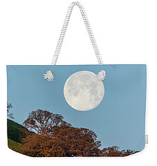 Weekender Tote Bag featuring the photograph March Moonset by Marc Crumpler