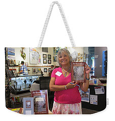 Weekender Tote Bag featuring the photograph Marie And The Recordkeeper by Marie Neder