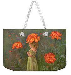 Weekender Tote Bag featuring the painting Marigold Flower Fairy by Nancy Lee Moran