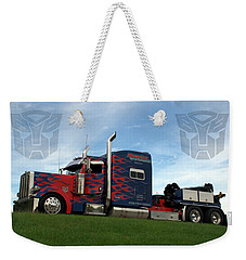 Weekender Tote Bag featuring the photograph Transformers Optimus Prime Tow Truck by Tim McCullough