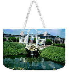 Weekender Tote Bag featuring the photograph Mary's Grotto by Desline Vitto