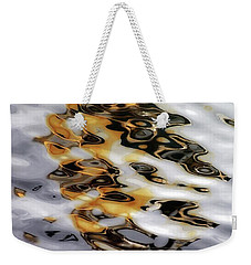 Weekender Tote Bag featuring the photograph Masquerade 1 by Newel Hunter