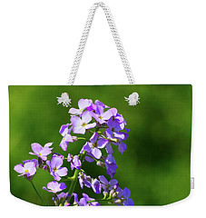 Weekender Tote Bag featuring the photograph Mauve Flowers  by Lyle Crump