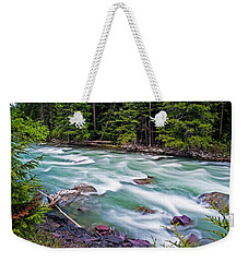 Weekender Tote Bag featuring the photograph Mcdonald Creek by Gary Lengyel
