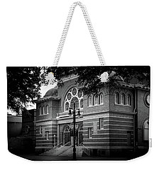 Weekender Tote Bag featuring the photograph Mcglohon Theatre At Spirit Square In Black And White by Greg Mimbs