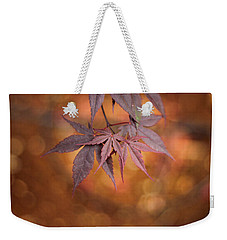Weekender Tote Bag featuring the photograph Mesmerize  by Viviana  Nadowski