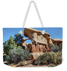 Weekender Tote Bag featuring the photograph Metate Arch - Devils Garden by Nikolyn McDonald