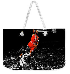 Michael Jordan Suspended In Air Weekender Tote Bag by Brian Reaves
