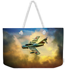 Weekender Tote Bag featuring the photograph Mikoyan-gurevich Mig-15uti by Chris Lord