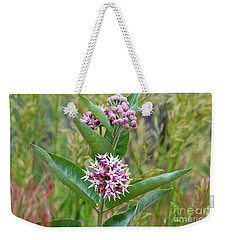 Weekender Tote Bag featuring the photograph Milkweed In Bloom by Ann E Robson