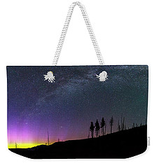 Weekender Tote Bag featuring the photograph Milky Way And Aurora Borealis by Cat Connor