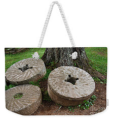 Weekender Tote Bag featuring the photograph Mill Stone by Eric Liller