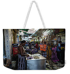 Weekender Tote Bag featuring the photograph Mincing Garlic by Mike Reid