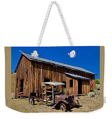 Weekender Tote Bag featuring the photograph Mining Relic by Todd Kreuter