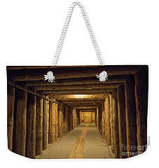 Weekender Tote Bag featuring the photograph Mining Tunnel by Juli Scalzi