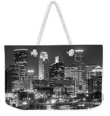 Weekender Tote Bag featuring the photograph Minneapolis City Skyline At Night by Jim Hughes