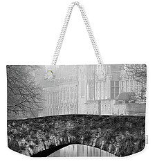 Weekender Tote Bag featuring the photograph Misty Morning Canal In Bruges by Barry O Carroll