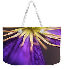 Weekender Tote Bag featuring the photograph Mitey Clamatis by Nancy Marie Ricketts