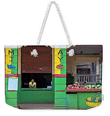 Weekender Tote Bag featuring the photograph Mjay Fruit Stand Havana Cuba by Charles Harden