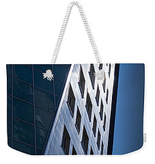 Weekender Tote Bag featuring the photograph Blue Modern Apartment Building by John Williams