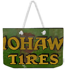 Weekender Tote Bag featuring the photograph Mohawk Tires Antique Sign by Chris Flees