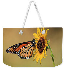 Weekender Tote Bag featuring the photograph Monarch Butterfly On Sun Flower by Sheila Brown