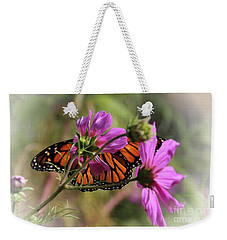 Weekender Tote Bag featuring the photograph Monarch Butterfly On The Pink Cosmos by Yumi Johnson