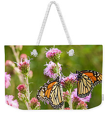 Weekender Tote Bag featuring the photograph Monarch Butterfly Pair Square Format by Heidi Hermes