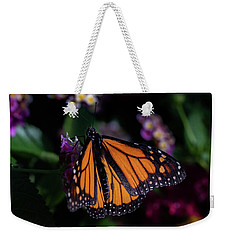 Weekender Tote Bag featuring the photograph Monarch by Jay Stockhaus