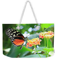 Monarch On Flower Weekender Tote Bag by Angela Murdock