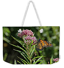 Weekender Tote Bag featuring the photograph Monarch On Milkweed by Sandy Keeton