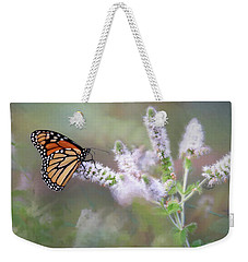 Weekender Tote Bag featuring the photograph Monarch On Mint 1 by Lori Deiter