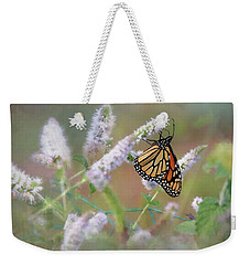 Weekender Tote Bag featuring the photograph Monarch On Mint 2 by Lori Deiter
