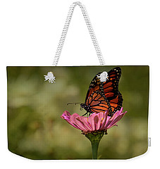 Weekender Tote Bag featuring the photograph Monarch On Pink Zinnia by Ann Bridges