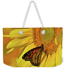 Weekender Tote Bag featuring the photograph Monarch On Sunflower by Ann Bridges