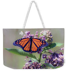 Weekender Tote Bag featuring the photograph Monarch On The Milkweed by Kerri Farley