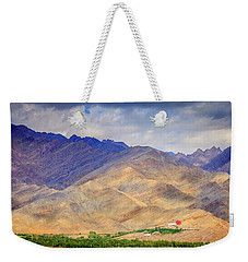 Weekender Tote Bag featuring the photograph Monastery In The Mountains by Alexey Stiop