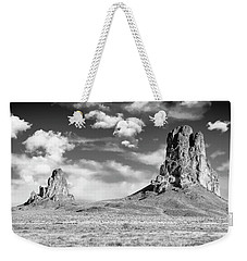 Weekender Tote Bag featuring the photograph Monoliths by Jon Glaser