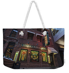 Weekender Tote Bag featuring the photograph Monroe St Steakhouse by Nicholas Grunas