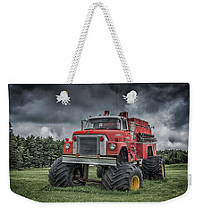 Weekender Tote Bag featuring the photograph Monster Fire Truck by Guy Whiteley