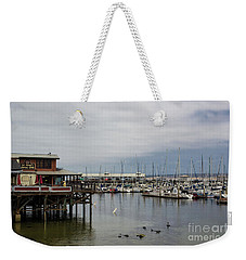 Weekender Tote Bag featuring the photograph Monterey Wharf Meets Harbor by Suzanne Luft
