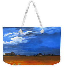 Weekender Tote Bag featuring the painting Monument Valley Clouds by LaVonne Hand
