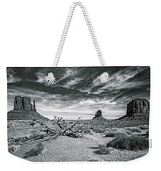 Weekender Tote Bag featuring the photograph Monument Valley by Lou Novick