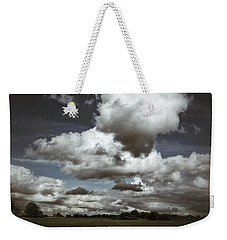 Weekender Tote Bag featuring the photograph Moodiness In The Clouds by Karen Stahlros