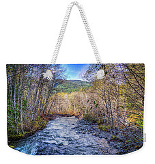 Weekender Tote Bag featuring the photograph Moody Blue River by Spencer McDonald