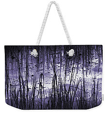 Weekender Tote Bag featuring the photograph Moody Mud by Laura Ragland