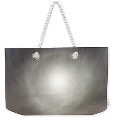 Weekender Tote Bag featuring the photograph Moon Dog by Leland D Howard