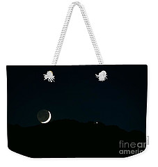 Weekender Tote Bag featuring the photograph Moon Greets Tram by Angela J Wright